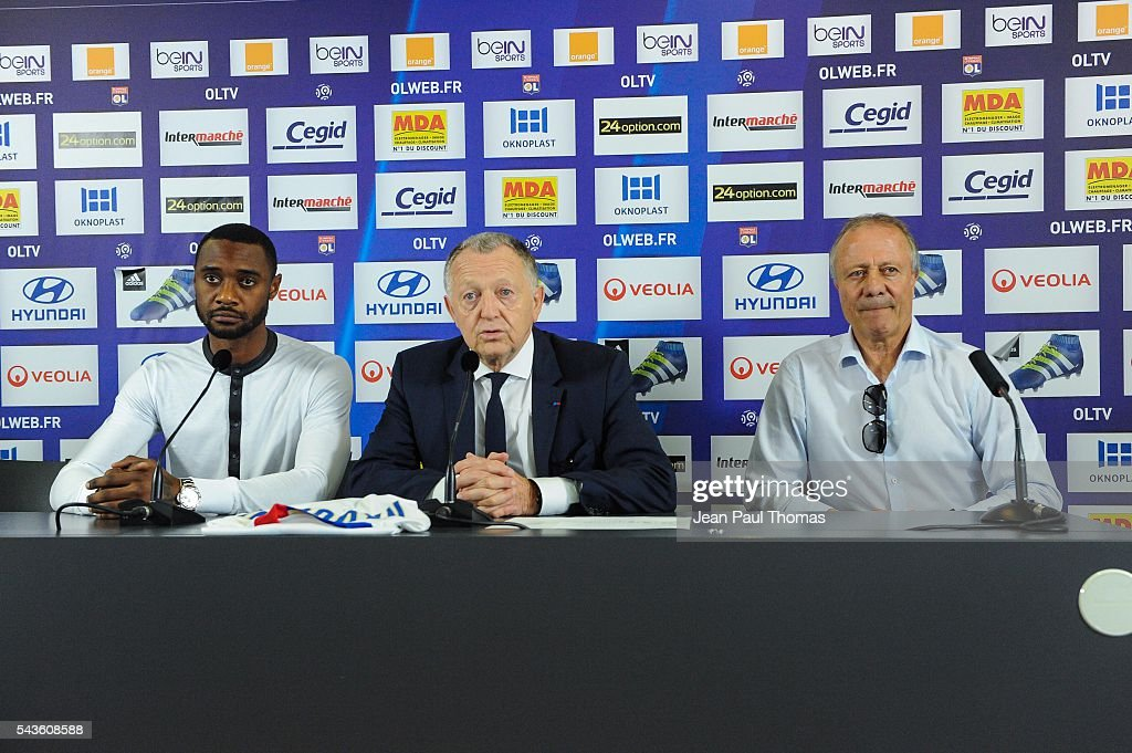 New signing player of Olympique Lyonnais Nicolas Nkoulou, president Jean Michel Aulas and Bernard Lacombe during press conference on June 29, 2016 in Lyon, France.