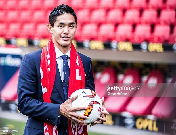 New signing player Yoshinori Muto of 1 FSV Mainz 05 poses during his unveiling at Coface Arena during on July 9 2015 in Mainz Germany