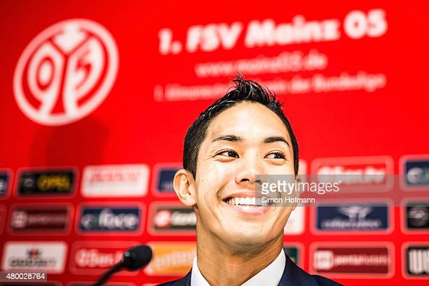 New signing player Yoshinori Muto of 1 FSV Mainz 05 smiles during an unveiling press conference at Coface Arena during on July 9 2015 in Mainz Germany