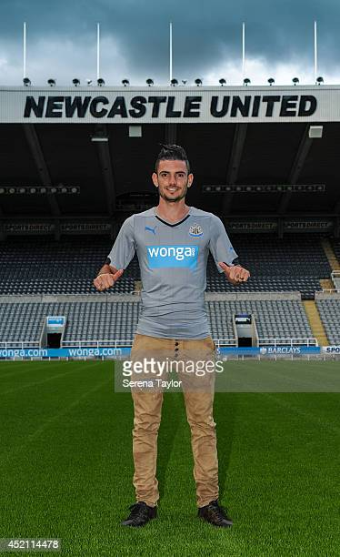 New signing Remy Cabella poses for photographs pitch side at StJames' Park on July 13 2014 in Newcastle upon Tyne England