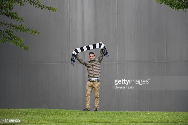 New signing Remy Cabella poses for photographs whilst holding a Newcastle United Scarf at The Newcastle United Training Centre on July 13 2014 in...