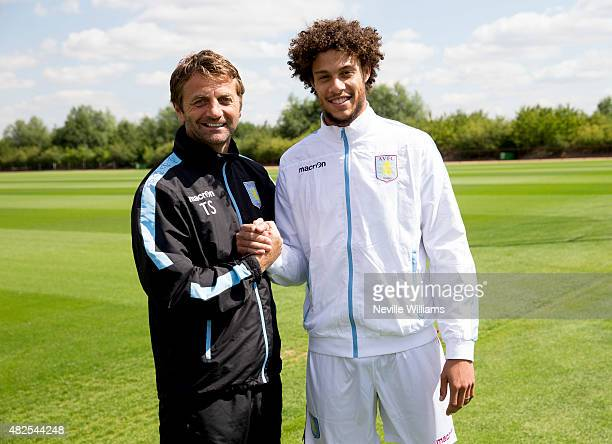 New signing Rudy Gestede of Aston Villa poses for a picture with Aston Villa manager Tim Sherwood at the club's training ground at Bodymoor Heath on...