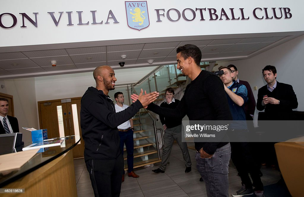 New signing Scott Sinclair of Aston Villa is greeted by Fabian Delph at the club's training ground at Bodymoor Heath on January 28, 2015 in Birmingham, England.