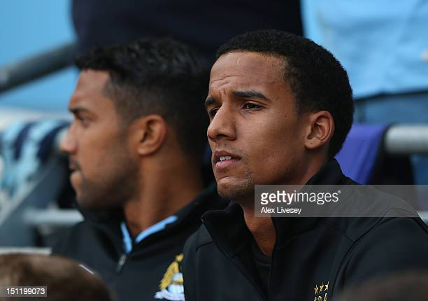 New signing Scott Sinclair of Manchester City watches from the bench during the Barclays Premier League match between Manchester City and Queens Park...