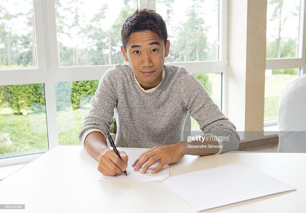 New signing Shinji Kagawa of Dortmund signs his new Borussia Dortmund contract on August 31 2014 in Dortmund Germany