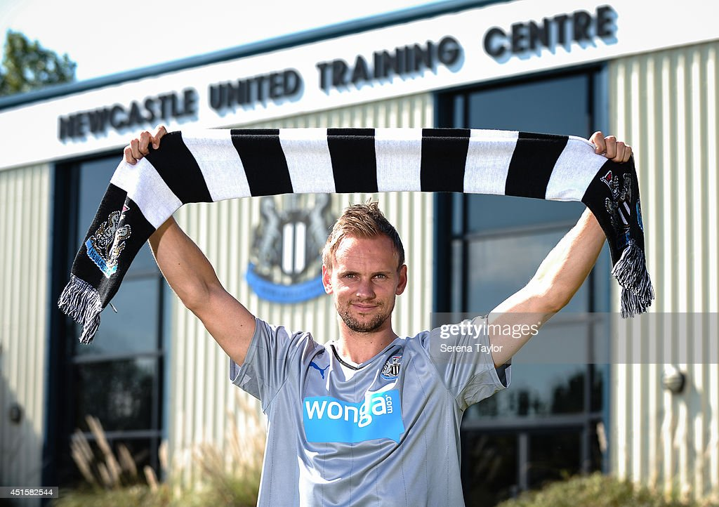 New signing Siem de Jong poses for photographs holding a Newcastle United scarf outside of the The Newcastle United Training Centre on July 01, 2014 in Newcastle upon Tyne, England.