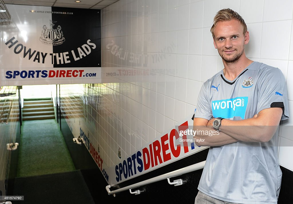New signing Siem de Jong poses for photographs in the tunnel at St.James' Park on July 01, 2014 in Newcastle upon Tyne, England.