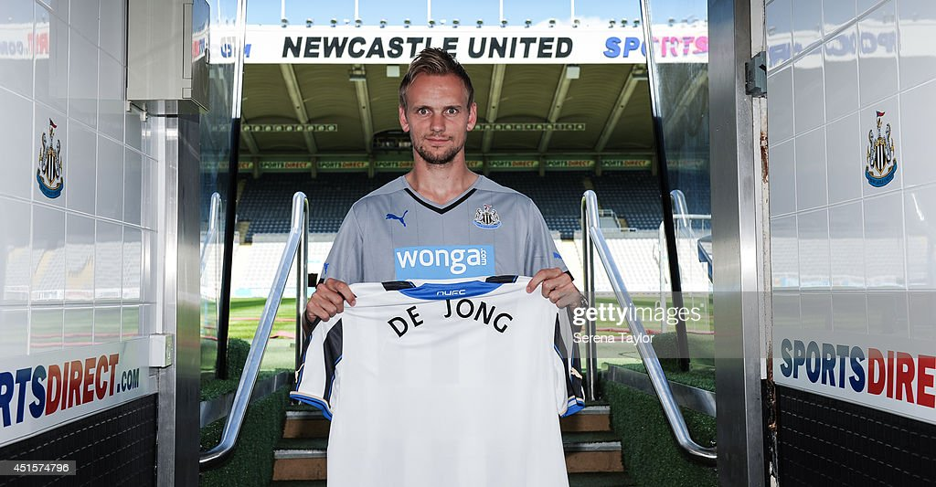 New signing Siem de Jong poses for photographs in the tunnel holding a Newcastle United Shirt at St.James' Park on July 01, 2014 in Newcastle upon Tyne, England.