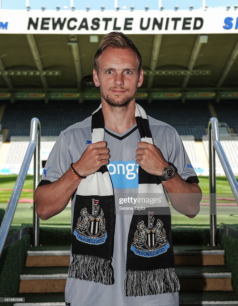 New signing Siem de Jong poses for photographs in the tunnel holding a Newcastle United scarff at St.James' Park on July 01, 2014 in Newcastle upon Tyne, England.