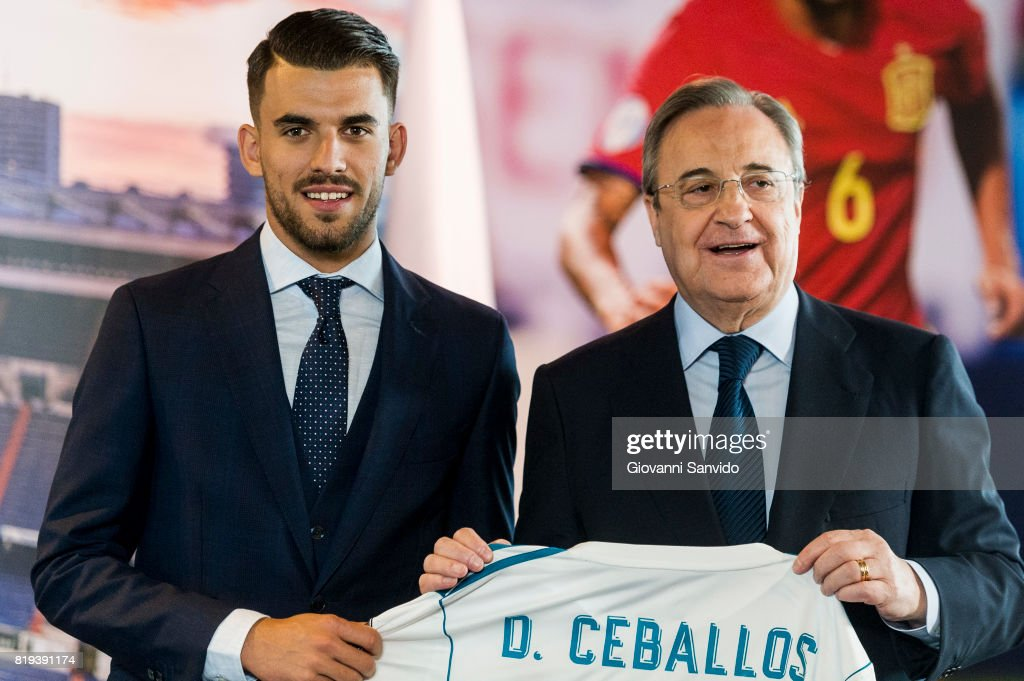 New signing Spanish midfielder Dani Ceballos of Real Madrid poses with Florentino Perez, President of Real Madrid at the Santiago Bernabeu stadium at Bernabeu on July 20, 2017 in Madrid, Spain.