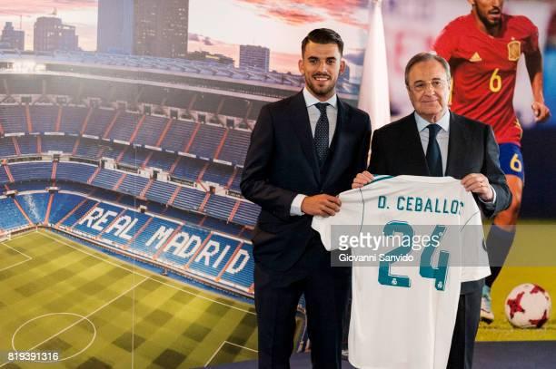 New signing Spanish midfielder Dani Ceballos of Real Madrid poses with Florentino Perez President of Real Madrid at the Santiago Bernabeu stadium at...