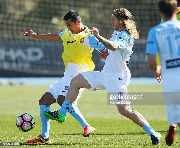 New signing Tim Cahill and Luke Brattan compete for the ball during a Melbourne City ALeague press conference at La Trobe University Sports Fields on...