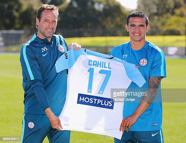 New signing Tim Cahill holds up his new jumper with City head coach John van't Schip during a Melbourne City ALeague press conference at La Trobe...