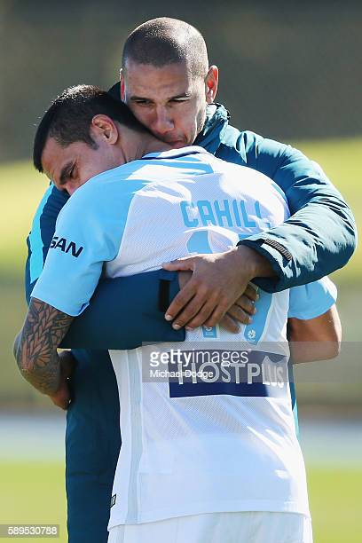 New signing Tim Cahill is hugged by recently retired City Captain Patrick Kisnorbo during a Melbourne City ALeague training session at La Trobe...