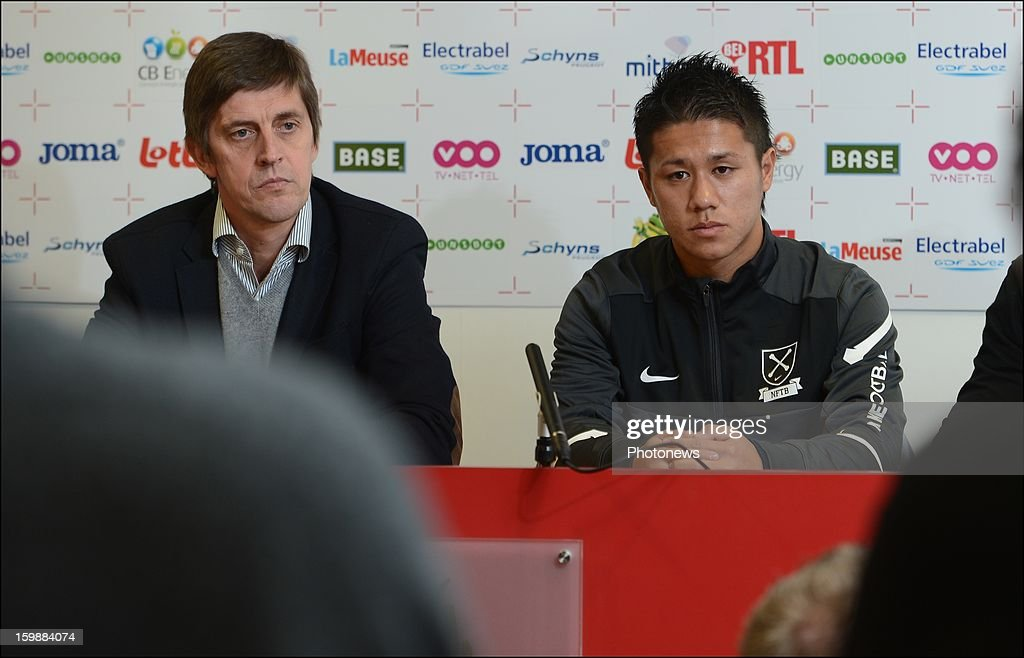 New signing Yuji Ono and Assistant coach Jean-Francois de Sart of Standard Liege attend a press conference to announce his signing to the club on January 22, 2013 in Liege, Belgium.