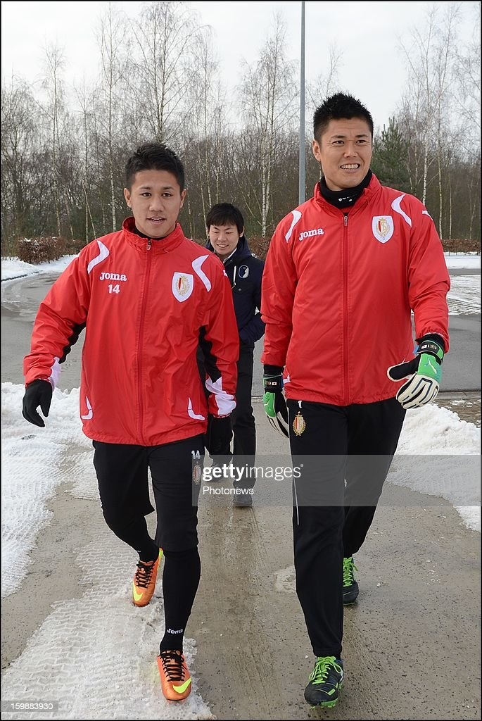 New signing Yuji Ono and <a gi-track='captionPersonalityLinkClicked' href=/galleries/search?phrase=Eiji+Kawashima&family=editorial&specificpeople=3117136 ng-click='$event.stopPropagation()'>Eiji Kawashima</a> of Standard Liege attend a training session on January 22, 2013 in Liege, Belgium.