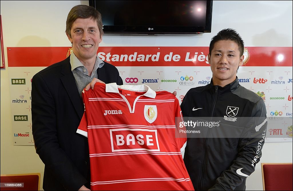 New signing Yuji Ono poses with Assistant coach Jean-Francois de Sart of Standard Liege during press conference to announce his signing to the club on January 22, 2013 in Liege, Belgium.