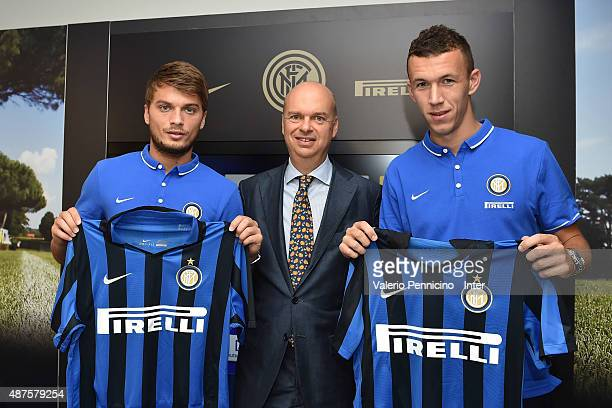 New signings Adem Ljajic and Ivan Perisic of FC Internazionale Milano pose with the club shirt and FC Internazionale Milano general manager Marco...