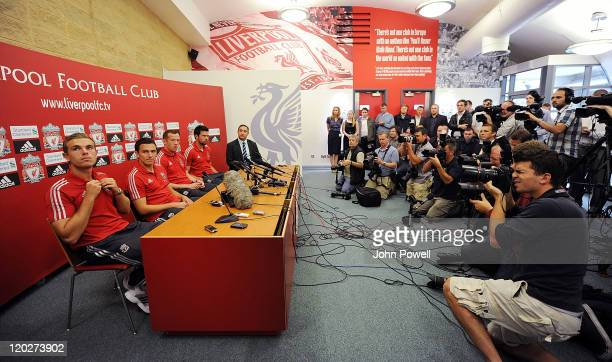 New signings Charlie Adam Alexander Doni Stewart Downing and Jordan Henderson of Liverpool attend a press conference at Melwood Training Ground on...