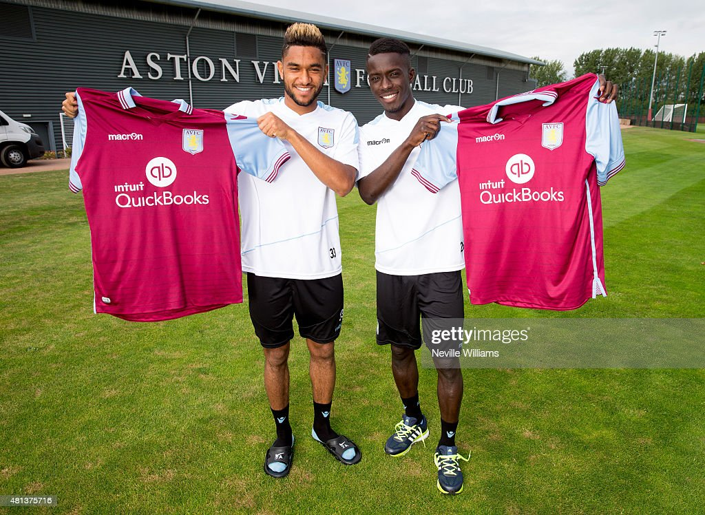 New signings Jordan Amavi (L) and <a gi-track='captionPersonalityLinkClicked' href=/galleries/search?phrase=Idrissa+Gueye&family=editorial&specificpeople=7312174 ng-click='$event.stopPropagation()'>Idrissa Gueye</a> of Aston Villa pose for pictures at the club's training ground at Bodymoor Heath on July 20, 2015 in Birmingham, England.