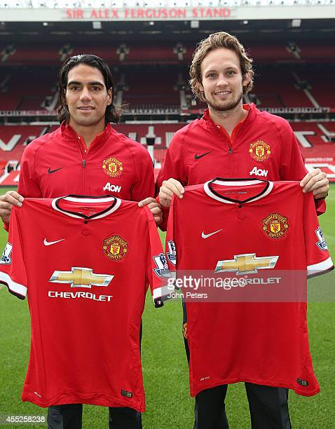 New signings Radomel Falcao and Daley Blind of Manchester United pose ahead of a press conference at Old Trafford on September 11 2014 in Manchester...