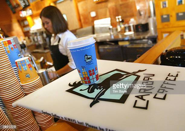 A new 'Skinny'Bou Latte' awaits its pickup in a Caribou Coffee store January 2 2004 in Mount Prospect Illinois Caribou Coffee Company Inc has...