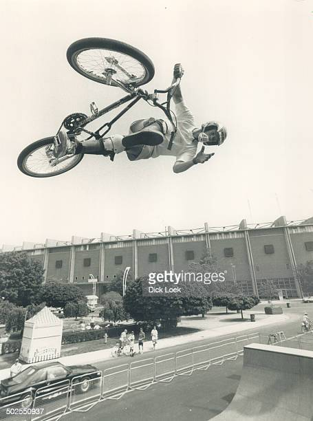 New slant on the ex Daredevil cyclist Creig Litherland 19 flies above Exhibition Place yesterday in a practice session for the Freestyle BMX show The...