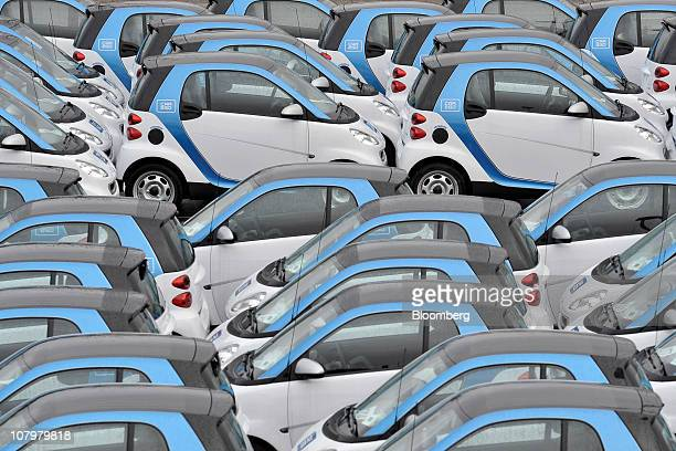 New Smart micro hybrid drive vehicles sit ready for dispatch to Daimler AG's Car2go rental service in Ulm Germany on Monday Jan 10 2011 Daimler's...