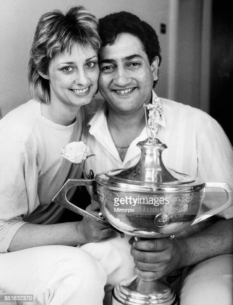 New snooker World Champion Joe Johnson holds on to the trophy with his wife Terryll the day after his surprise win over Steve Davis in the World...