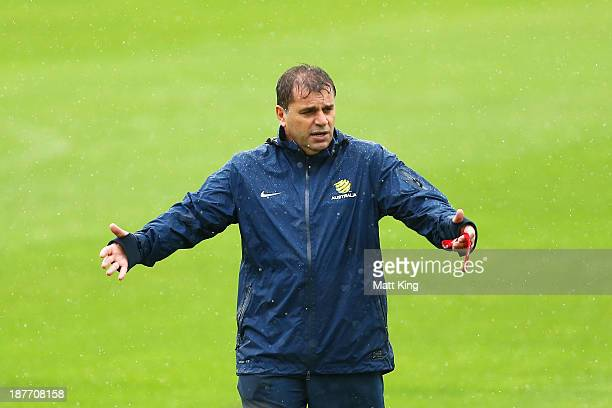 New Socceroos head coach Ange Postecoglou interacts with players during an Australian Socceroos training session at WIN Jubilee Stadium on November...