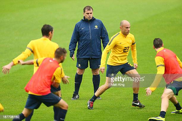 New Socceroos head coach Ange Postecoglou watches players training during an Australian Socceroos training session at WIN Jubilee Stadium on November...