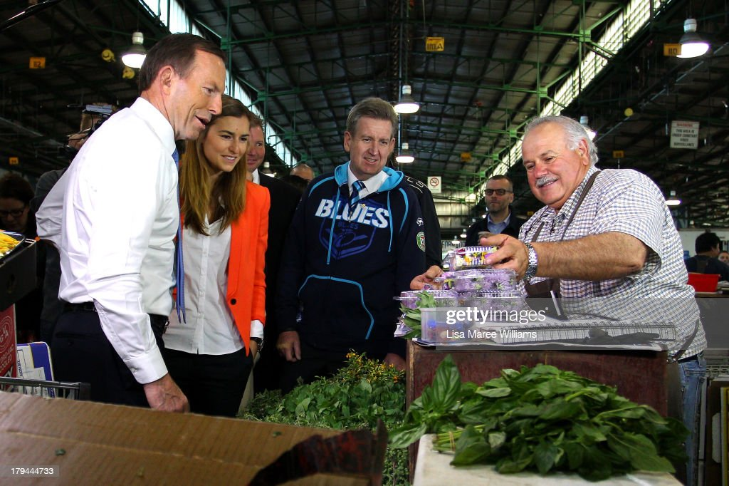 New South Wales Premier Barry O'Farrell, and Frances Abbott join Australian Opposition Leader, <a gi-track='captionPersonalityLinkClicked' href=/galleries/search?phrase=Tony+Abbott&family=editorial&specificpeople=220956 ng-click='$event.stopPropagation()'>Tony Abbott</a> on the campaign at Sydney Markets on September 4, 2013 in Sydney, Australia. With just three days of campaigning before Saturday's Federal Election it looks increasingly unlikely that the Australian Labor Party will hold on to government as the Liberal-National Party coalition pulls ahead in polling.