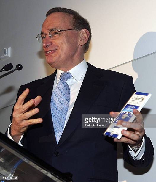 New South Wales Premier Bob Carr holds a chocolate bar at the opening of the Lindt Concept Store and Cafe the first of its type in the world November...