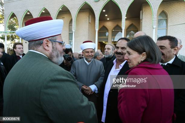 New South Wales' Premier Gladys Berejiklian talks with Sheikh Yahya Safi imam of the Lekamba mosque after an Eid alFitr prayer in western Sydney on...