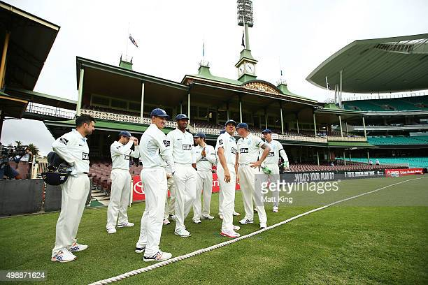 New South Wales prepare to take the field during day one of the Sheffield Shield match between New South Wales and Queensland at Sydney Cricket...