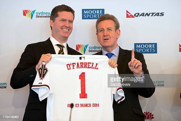 New South Wales state Premier Barry O'Farrell gestures while holding and Arizona Diamondbacks baseball jersey along with Tim Slavin senior counsel...