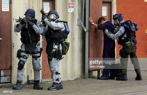 New South Wales tactical operations unit police arrest a 'terrorist' during a mock counter terror operation at a training facility December 19 2002...