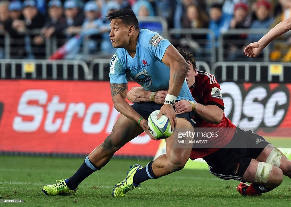 New South Wales Waratahs fullback Israel Folau (C) is tackled by Canterbury Crusaders flanker Matt Todd (L) in the Super 15 rugby union final in Sydney on August 2, 2014. AFP PHOTO/William WEST --IMAGE RESTRICTED TO EDITORIAL USE - STRICTLY NO COMMERCIAL USE--