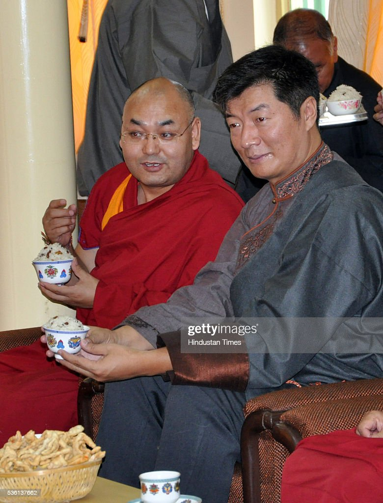 New speaker of the 16th Tibetan Parliament-in-Exile Khenpo Sonam Tenphel and Tibetan PM-in-Exile Lobsang Sangay talking together during the oath ceremony on May 31, 2016 at Dharamsala, India.