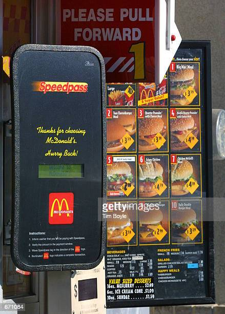 A new Speedpass receiver is placed near the driveup window lane at a McDonald's restaurant January 10 2001 in Rosemont IL A customer in their vehicle...