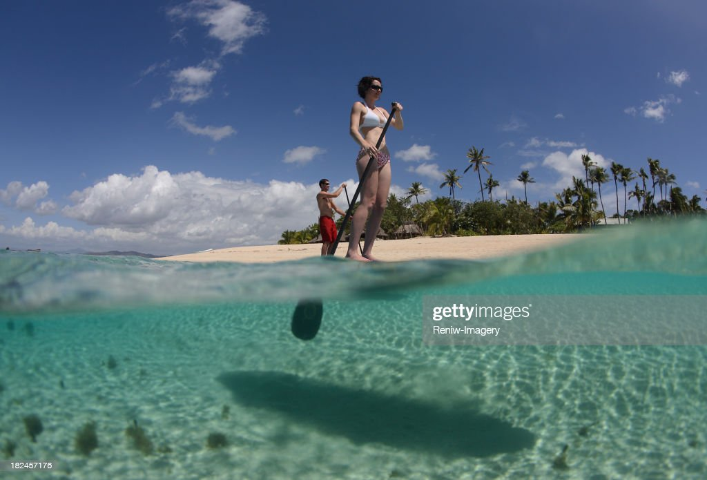 new sports trend  stand-up Paddle boarding