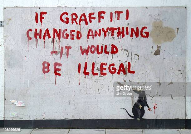 A new stencil and spray paint artwork by guerilla graffiti artist Banksy appears in Fitzrovia October 6 2011 in London England The piece that shows a...