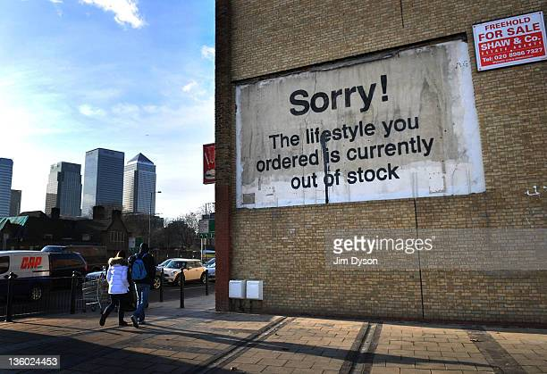 A new stencil and spray paint artwork by guerilla graffiti artist Banksy appears in East London on December 20 2011 in London England The piece...