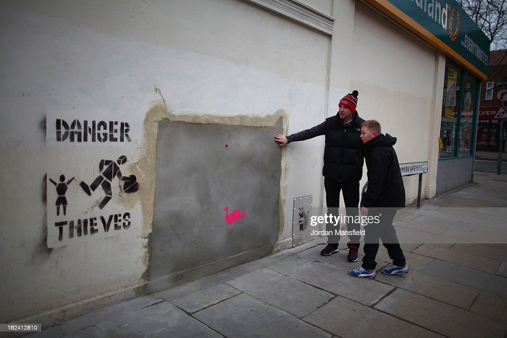 A new stenciled rat appears on the side of Poundland on Whymark Avenue beside where the old Banksy artwork has been removed on February 23, 2013 in London, England. The original Banksy artwork, entitled 'Slave Labour', was removed last week and is due to go up for auction today in Miami for an estimated price of 500,000 GBP. Frederic Thut, the owner of Fine Art Auctions Miami gallery, has been subjected to abusive phone calls and emails from the UK following the announcement of the piece's sale after its sudden, mysterious disappearance.
