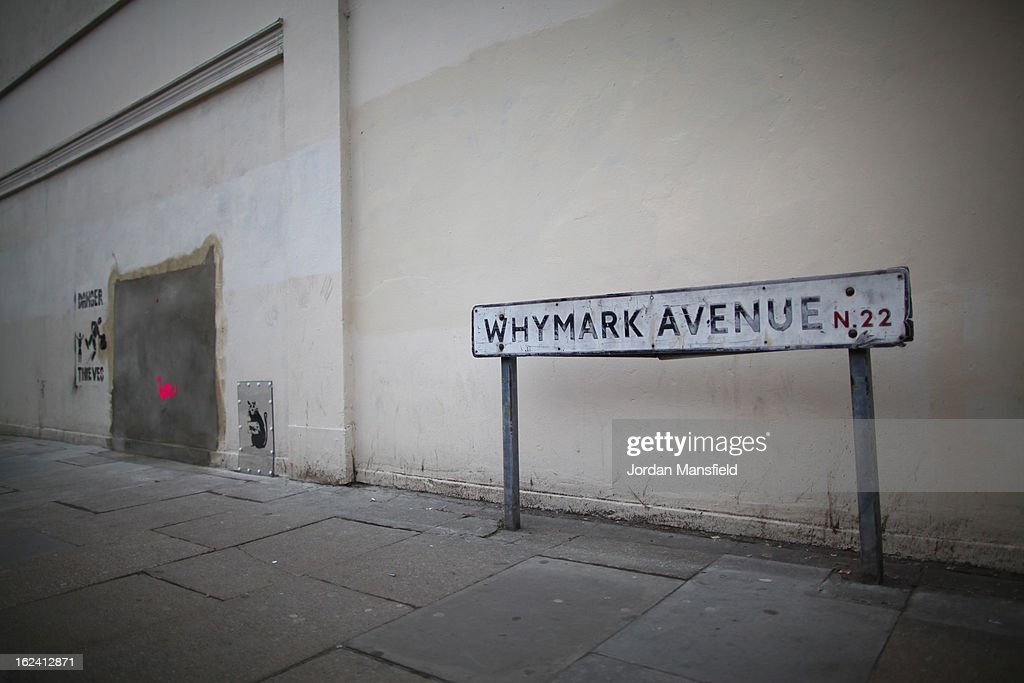 A new stenciled rat appears on the side of Poundland on Whymark Avenue beside where the old Banksy artwork was removed from on February 23, 2013 in London, England. The original Banksy artwork, entitled 'Slave Labour', was removed last week and is due to go up for auction today in Miami for an estimated price of 500,000 GBP. Frederic Thut, the owner of Fine Art Auctions Miami gallery, has been subjected to abusive phone calls and emails from the UK following the announcement of the piece's sale after its sudden, mysterious disappearance.