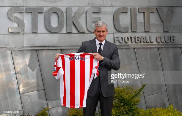New Stoke City manager Mark Hughes poses for a photograph during the press conference at the Clayton Wood Training Ground on May 30 2013 in...