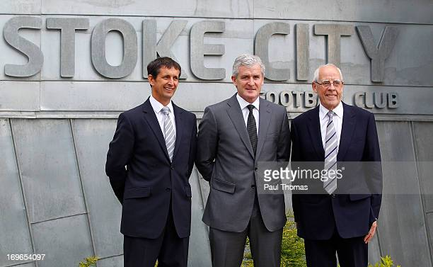 New Stoke City manager Mark Hughes poses for a photograph with Chief Executive Tony Scholes and Stoke City owner Peter Coates during the press...