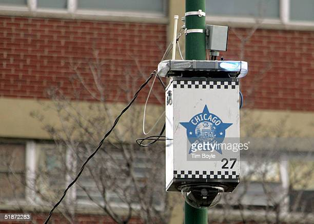 A new street surveillance camera in seen on top of a light pole along a street December 16 2004 in Chicago Illinois The Chicago Office of Emergency...