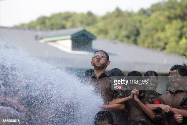 New students of a middle school face the lash from a water cannon during a military training on August 18 2017 in Hangzhou Zhejiang Province of China...