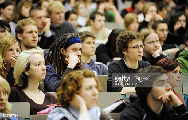 New students sit and listen as they are welcomed in one of the lecture halls of the Johannes Gutenberg University in Mainz western Germany on April 9...